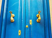 Ancient door in a house in malta island. Door in a house in malta island with art handle Stock Photo