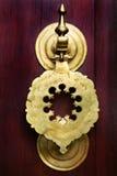 Ancient door knocker. Vintage image of ancient door knocker on a wooden door Stock Photo