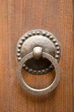 Ancient door knocker. Ancient metal clapper Tuscany Italy Royalty Free Stock Images