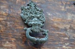 Ancient door knocker. On a wood door royalty free stock photos