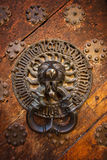 Ancient door knocker Royalty Free Stock Photo
