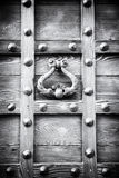 Ancient door knocker of a medieval portal Stock Image