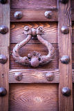 Ancient door knocker of a medieval portal Stock Photos