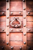 Ancient door knocker of a medieval portal Royalty Free Stock Photos