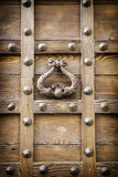 Ancient door knocker of a medieval portal Royalty Free Stock Photography