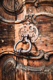 Ancient door knocker of a medieval portal. Royalty Free Stock Photography