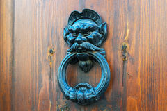 Ancient door knocker on a wooden door in Rome Royalty Free Stock Photos