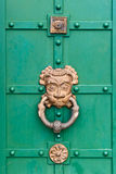 Ancient door with a large metal handle Stock Photography