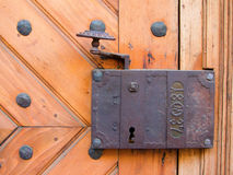 Old lock. Ancient door lock from a medieval house. With date imprinted Royalty Free Stock Photos