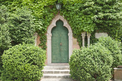 Ancient door in a luxurious vegetation Royalty Free Stock Images