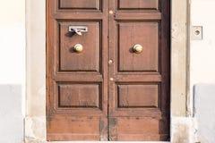 An ancient door in a main street of Pisa, Italy. An ancient door in a main street of Pisa, Tuscany, Italy stock photos
