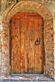 Ancient door in the monastery. Ancient wooden door in the monastery Stock Photography