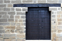 Ancient door with nails Royalty Free Stock Photo
