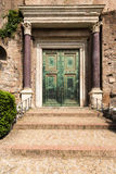 Ancient door in Rome. The Roman Forum is a rectangular forum surrounded by the ruins of several important ancient government buildings at the center of the city Royalty Free Stock Photos