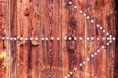 Ancient door with rusty nails in the form of arrow Stock Photos