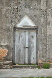 Ancient door and wall of temple Royalty Free Stock Photos
