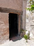 Ancient door with wood lintel  in Carmel Mission museum Stock Photo