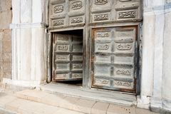 Ancient doors of medieval cathedral Stock Photo