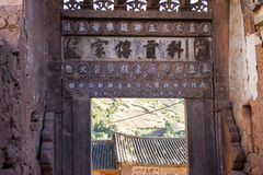 Ancient Doorway. Looking through the gate of a 500 year old building in the ancient village of Nuodeng in Yunnan province in southern China Stock Photo