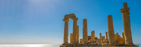 Ancient doric architecture of Acropolis Temple of Juno. Valley of the Temples in Agrigento on Sicily, Italy. Tourist place. Wide banner stock photography