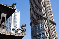 Ancient dragon looked at modern city Stock Images