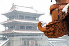 Ancient dragon stone eaves. On a snowy day.The Zhaoling (or Northern Mausoleum) is the cemetery of Huangtaiji and his wife Borjigid Stock Image