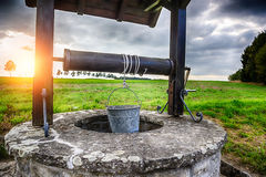 Ancient draw-well in European village Royalty Free Stock Images