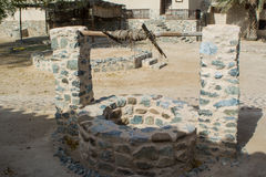 Ancient draw-well made from stone in arabian village Royalty Free Stock Photo