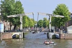 Ancient drawbridge in Amsterdam Old Town. Stock Photos