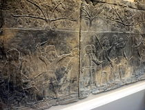 Ancient drawings. Ancient Egyptian drawings on wall with working men in national history museum in London Stock Photo