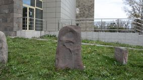 Ancient drawings on stones of the Asian steppe. The stone is installed near the Museum, for universal access. Russia. Khakassia. stock video footage