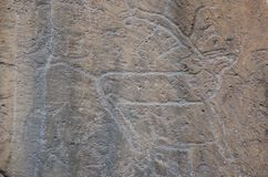 Ancient drawings on stones of the Asian steppe. Permission is not necessary. The stone is installed near the Museum Royalty Free Stock Photography