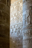 The ancient drawings on the wall. Ancient frescos on the walls and columns of the temple Royalty Free Stock Photo
