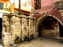 Ancient drinking fountain  in a brick wall Rethymno. Ancient drinking fountain in a brick wall with decor in Rethymno, Crete royalty free stock photos