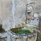 Ancient drinking fountain Royalty Free Stock Photo