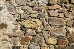 Ancient dry stone wall bricks texture. Close up view stock images