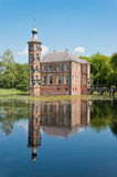 An ancient Dutch castle Bouvireflected in the pond. An ancient Dutch castle reflected in the pond. The castle Bouvigne dates from the 15th century. The sky is Stock Images