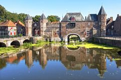 Ancient Dutch city gate Koppelpoort in Amersfoort. The Netherlands, Utrecht province, city Amersfoort: the water and land gate the Koppelpoort. The river Eem Royalty Free Stock Photo
