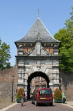 Ancient Dutch city gate Veerpoort and busy traffic. Netherlands, South Holland province; region, area Krimpenerwaard; city; small town Schoonhoven: In the street Royalty Free Stock Photos