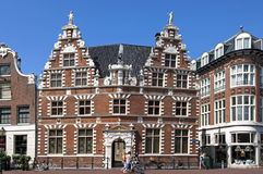 Ancient Dutch City Hall and people in Hoorn Royalty Free Stock Images