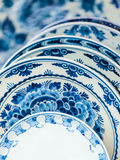 Ancient Dutch dishware from Delft Royalty Free Stock Image