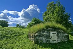 Ancient earth house. Near medieval Russian fortress stock photography