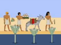 Ancient Egypt caravan travels through the desert. Egyptian traders with donkey travels througth the desert. Royalty Free Stock Image