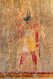 Ancient egypt color image of anubis. On wall in luxor stock image