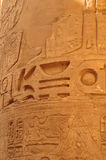 Ancient Egypt. The columns are decorated with carved hieroglyphs. Karnak Temple. Stock Photography