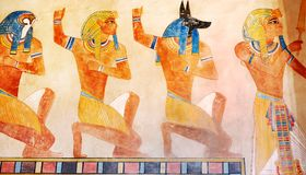 Ancient Egypt scene, mythology. Egyptian gods and pharaohs. Hier. Oglyphic carvings on the exterior walls of an ancient temple. Egypt background. Murals ancient Stock Photography