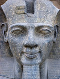 Ancient Egypt Statue Face of the Pharaoh Closeup. The detail and skill of the ancient Egyptian people can be seen in this stone carving of the pharaoh Stock Image