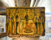 Ancient Egyptian Artifact in Museum. Detail of Decorative Ancient Egyptian Artifact in Museum, Depicting High Priest or Priestess Surrounded by Gods or Servants Stock Photography