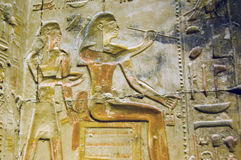 Ancient Egyptian Artist hieroglyph, Abydos. A decorated hieroglyphic carving of an ancient egyptian artist painting on a wall.  Inner wall at the Temple of Royalty Free Stock Image
