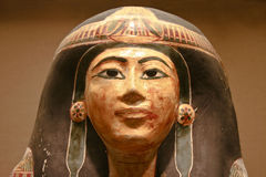 Ancient Egyptian decorated sarcophagus of a woman. Woman head polychromed sarcophagus, Ancient Egyptian Art Royalty Free Stock Photo